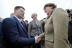 © Licensed to London News Pictures. 13/05/2017. Lisburn, UK. British prime minister THERESA MAY  meets with DUP leader Arlene Foster's during a visit to Balmoral Show at Balmoral Park in Lisburn, Northern Ireland, with Secretary of State for Northern Ireland JAMES BROKENSHIRE (left),  while campaigning ahead of a general election which takes place on June 8, 2017.  Photo credit: Kalista McErlane/LNP