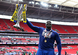Adebayo Akinfenwa of AFC Wimbledon lifts the League Two Playoff Trophy - Mandatory by-line: Robbie Stephenson/JMP - 30/05/2016 - FOOTBALL - Wembley Stadium - London, England - AFC Wimbledon v Plymouth Argyle - Sky Bet League Two Play-off Final