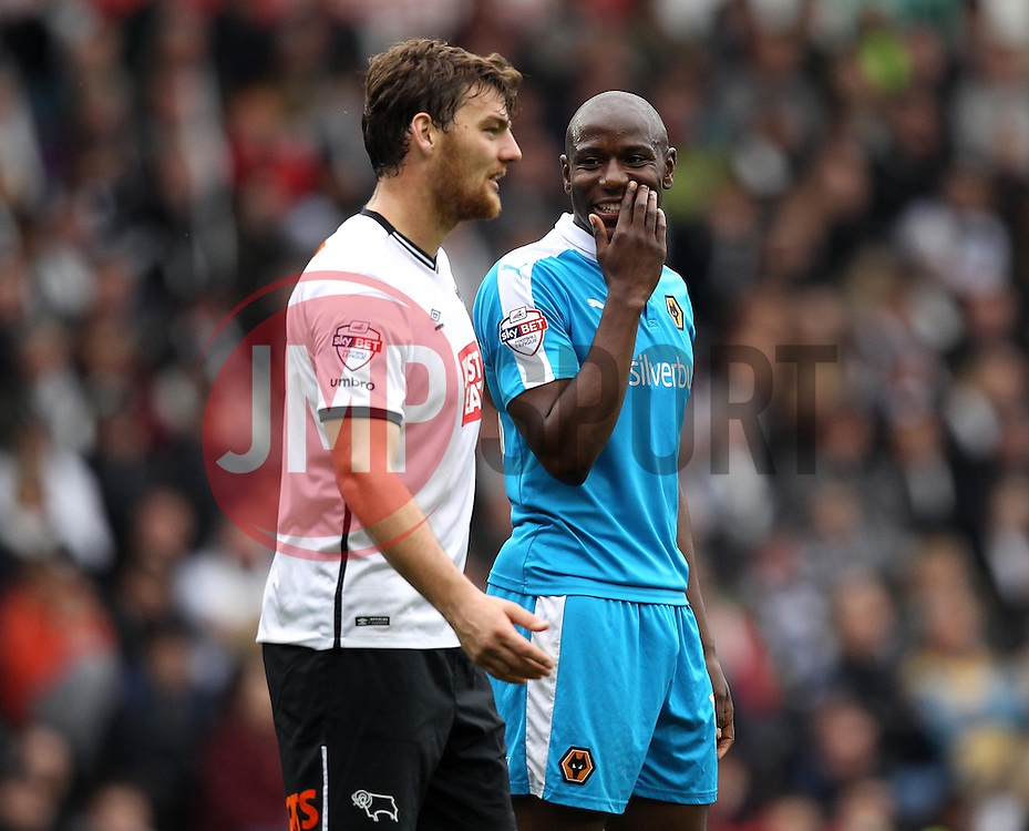 Benik Afobe of Wolverhampton Wanderers and Chris Martin of Derby County share a joke - Mandatory byline: Robbie Stephenson/JMP - 07966 386802 - 18/10/2015 - FOOTBALL - iPro Stadium - Derby, England - Derby County v Wolverhampton Wanderers - Sky Bet Championship