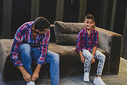 """Cristiano Ronaldo and his mini-me are two peas in a pod in this very cute photoshoot for the football star's new CR7 Junior denim line. The 32-year-old Real Madrid player and his seven-year-old son, Cristiano Ronaldo Jr, pose up a storm, flexing their muscles while shirtless and donning matching outfits. The CR7 Junior collection is available exclusively on CR7.com and markets itself as the """"future of denim"""" with """"unrivaled mobility"""". Speaking about the new line, Ronaldo explained: """"For me, the CR7 Junior collection is all about having fun and being free, being creative and confident. """"The stretch denim we have used in the collection is extremely comfortable due to the technical elements in the fabric, which will allow boys torun around and be active, move freely and most importantly, play."""" Ronaldo — who is also father to four-month-old twins Mateo and Eva Maria and whose girlfriend Georgina Rodriguez is pregnant with his fourth child — went on: """"This is why we have used the PRESS PLAY tagline for the brand. """"I believe the youth of today are the ones driving the society forward in so many ways and I felt that creating a denim collectionwith my son would celebratethis."""". 14 Nov 2017 Pictured: Cristiano Ronaldo and his son Cristiano Ronaldo Jr. pose together in a photoshoot for the Real Madrid star's new CR7 Junior denim line. Photo credit: CR7/ MEGA TheMegaAgency.com +1 888 505 6342"""