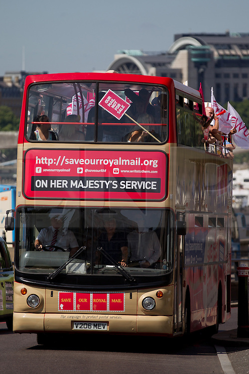 © Licensed to London News Pictures. 10/07/2013. London, UK. Postal workers and campaigners from the Communication Workers Union are seen arriving outside the Royal Mail headquarters on an open topped bus covered in slogans as they protest against privatisation of Royal Mail in London today (10/07/2013). Photo credit: Matt Cetti-Roberts/LNP