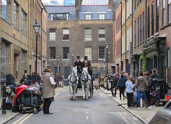 © Licensed to London News Pictures. 12/09/2017. London, UK. Extras, crew members and a horse and carriage are seen as new television series 'Vanity Fair' is filmed in Sptalfields in London. The mini series is being made for ITV and Amazon Prime and stars Tom Bateman and Michael Palin. Photo credit: Graham Long/LNP