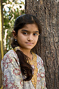 Portrait of a young girl, about 12 years old, wearing a block printed dress made by her father's studio.