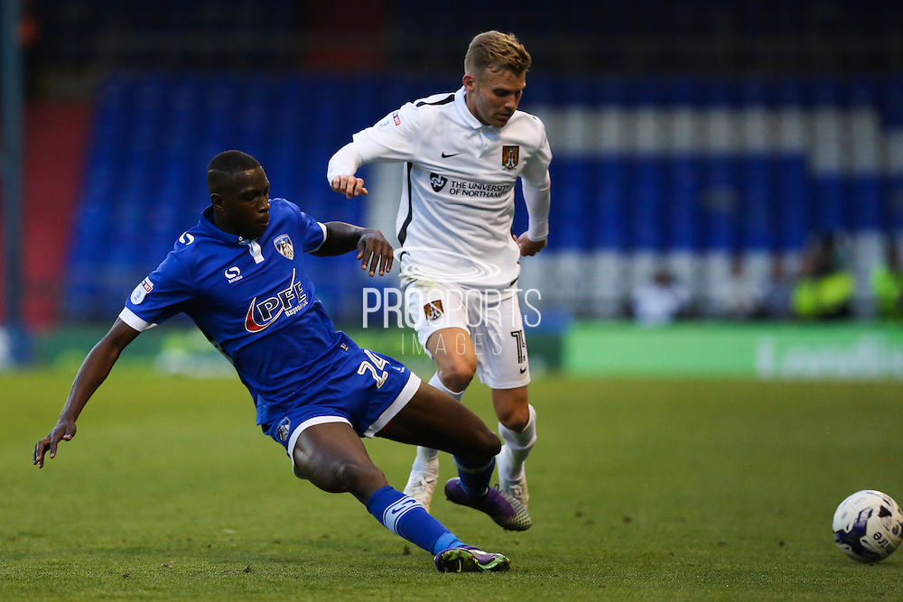 Ousmane Fané of Oldham Athletic tackles Alfie Potter of Northampton Town during the EFL Sky Bet League 1 match between Oldham Athletic and Northampton Town at Boundary Park, Oldham, England on 16 August 2016. Photo by Simon Brady.