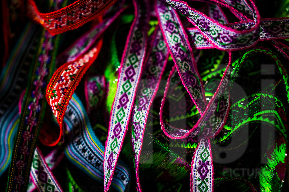 Colorful handmade patterned straps for sale in the market of Sapa, Vietnam, southeast Asia