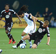 DC United forward Danny Allsopp attempts to steal the ball from Kansas City's Stephane Aubray. United defeated the Wizards 2-1 to earn their first points of the season.