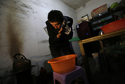 epa05830813 Chinese migrant worker Wang Pengfei washes his face in the early morning, as he prepares to return to his hometown for the Spring Festival in Beijing, China, 22 January 2017. Wang is the migrant worker and is working in the capital city as a delivery man. He will travel to visit his family in the Shandong Province for the annual Chinese Lunar New Year or Spring Festival. This is the only time he gets to see his family each year. Wang will join millions of fellow Chinese travelers making their way back home as they pack trains, planes and buses, in what is the largest human migration in the world. The journey, known as 'Chunyun' - the annual spring migration, will involve a total of 2,98 billion trips, starting from 13 January and continuing until 21 February 2017.  EPA/HOW HWEE YOUNG