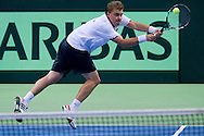 Marcin Matkowski of Poland competes at men's double game during the BNP Paribas Davis Cup 2014 between Poland and Croatia at Torwar Hall in Warsaw on April 5, 2014.<br /> <br /> Poland, Warsaw, April 5, 2014<br /> <br /> Picture also available in RAW (NEF) or TIFF format on special request.<br /> <br /> For editorial use only. Any commercial or promotional use requires permission.<br /> <br /> Mandatory credit:<br /> Photo by © Adam Nurkiewicz / Mediasport