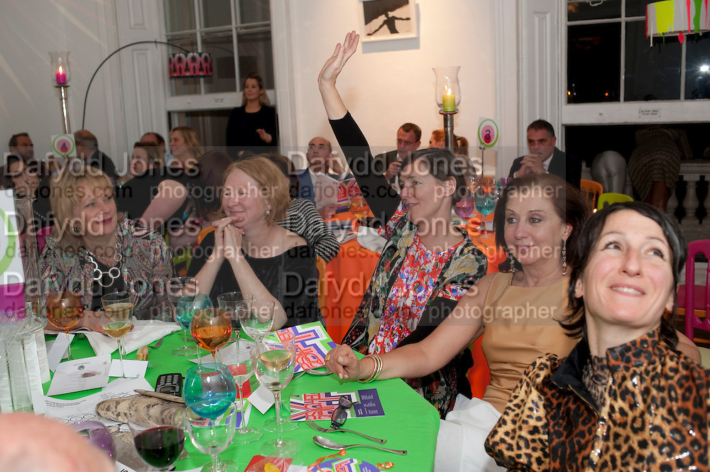 LOUISA BUCK; MARGOT HENDERSON; SADIE COLES BIDDING, The ICA's Psychedelica Gala Fundraising party. Institute of Contemporary Arts. The Mall. London. 29 March 2011. -DO NOT ARCHIVE-© Copyright Photograph by Dafydd Jones. 248 Clapham Rd. London SW9 0PZ. Tel 0207 820 0771. www.dafjones.com.