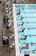 Swimmers take off in the girls 11-12 50 yard Backstroke event during the annual All City Competitive Swim Meet at Cherry Hill Aquatic Center in Cedar Rapids on Saturday, July 23, 2011. Swimmers ages 4 to 17 years old from all over the city competed in 74 events.