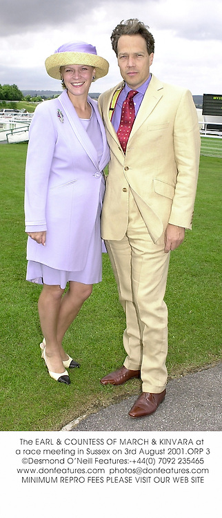 The EARL & COUNTESS OF MARCH & KINVARA at a race meeting in Sussex on 3rd August 2001.ORP 3