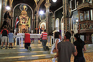 Visitors walking on knees to altar. La Basilica church; Cartago, Costa Rica.<br />