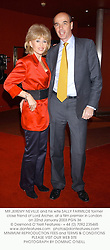 MR JEREMY NEVILLE and his wife SALLY FARMILOE former close friend of Lord Archer, at a film premier in London on 22nd January 2003.PGN 36