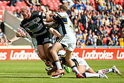 Hull FC loose forward and captain Gareth Ellis (13) is stopped during the Challenge Cup 2017 semi final match between Hull RFC and Leeds Rhinos at the Keepmoat Stadium, Doncaster, England on 29 July 2017. Photo by Simon Davies.