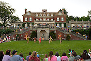 Old Westbury, New York, U.S. - June 21, 2014 - Five members of the Lori Belilove & The Isadora Duncan Dance Company take a bow on the South Lawn, with the rear of the mansion behind them, after 'In homage to Artemis, Goddess of the Hunt' the Finale of the Midsummer Night event at the Long Island Gold Coast estate of Old Westbury Gardens on the first day of summer, the summer solstice.