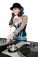 Happy tattooed DJ over white background