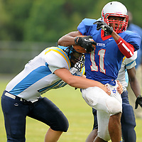 Pender High School's Rayshawn Deloach rushes against East Carteret in the opening game of The Pender County Jamboree Saturday August 16, 2014 at Trask High School. (Jason A. Frizzelle)