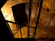 looking down in a dark dusty stairway