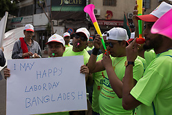 May 1, 2019 - Beirut, Lebanon - A worker seen holding a placard that says 1 may happy labor day Bangladesh during the protest..May is ''International labour day'' also known as May Day and it is a day for the workers to demand for more rights and against corruption, the misuse of public funds by the Lebanese government. (Credit Image: © Adib Chowdhury/SOPA Images via ZUMA Wire)