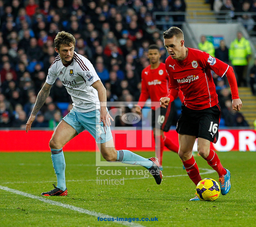 Picture by Mike  Griffiths/Focus Images Ltd +44 7766 223933<br /> 11/01/2014<br /> Craig Noone of Cardiff City and George McCartney of West Ham United during the Barclays Premier League match at the Cardiff City Stadium, Cardiff.