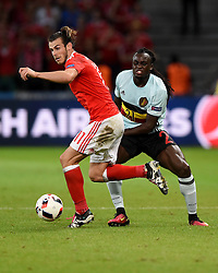 Jordan Lukaku of Belgium battles for the ball with Gareth Bale of Wales  - Mandatory by-line: Joe Meredith/JMP - 01/07/2016 - FOOTBALL - Stade Pierre Mauroy - Lille, France - Wales v Belgium - UEFA European Championship quarter final