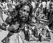 Indian man in traditional outfit piercing his lip during Shivaratri festival in the street in Gokarna, Karnataka, India, on February 19, 2015. Hindus across the country celebrate Mahashivratri, better known as Lord Shiva's wedding anniversary. Lord Shiva is also known as Nataraja, the Lord of Dancers.<br /> Photo by Oren Nahshon