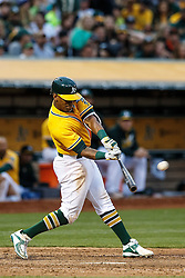 OAKLAND, CA - JUNE 17:  Khris Davis #2 of the Oakland Athletics hits a home run against the Los Angeles Angels of Anaheim during the fourth inning at the Oakland Coliseum on June 17, 2016 in Oakland, California. (Photo by Jason O. Watson/Getty Images) *** Local Caption *** Khris Davis
