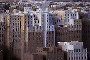 """Shibam. Declared Unesco World Heritage, the old city of Shibam on the incense road is called the """"Manhattan of the desert"""" and is one of the most celebrated Arabic Islamic cities built in traditional style. A collection of nearly 500 skyscrapers built with mud bricks and 5-7 stores high."""