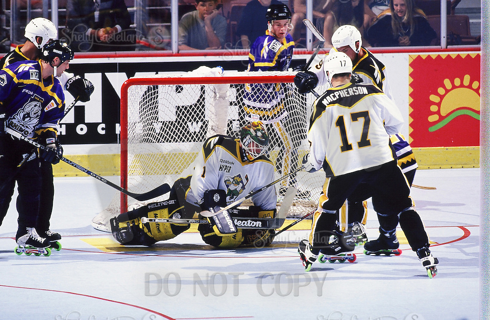 1999: Roller hockey goaltender Rob Laurie makes a save for the Anaheim Bullfrogs at the Pond. Transparency image scan.