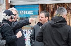 © London News Pictures. 21/03/2016. Director PAUL GREENGRASS (left pointing) and MATT DAMON (right) filming in Woolwich, East London for Jason Bourne, the fifth and latest film in the Bourne franchise. During the filming, parts of Woolwich were transformed to look like a street scene in Greece. Photo credit: Chris Mansfield/LNP