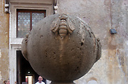 Stone sculpture of an orb covered in large relief versions of insects around it's surface. Found at the Castel Sant'Angelo, Rome, Italy. Roman, circa 2nd-3rd century AD.