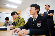 Vice principal Byung-Chul Shin is standing behind the students Kyung bae Kim, Yong mook Kim,  Soo jin Ahn and Ji hoon Park. Shinil High School, Seoul, South Korea.