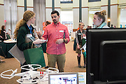 Tim Martin of Electronic Vision chats with visitors during the CCN Expo in Walter Hall Rotunday on Wednesday, May 13, 2015.  Photo by Ohio University  /  Rob Hardin