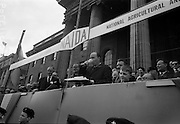 17/3/1966<br /> 3/17/1966<br /> 17 March 1966<br /> <br /> Irish Tea Merchant Display for the St. Patricks Day Parade Giving Dr. P.J. Hillery T.D. Minister for Industry and Commerce a cup of Tea