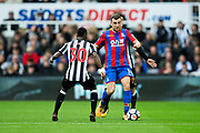 James McArthur (#18) of Crystal Palace shields the ball from the challenge of Javier Manquillo (#19) of Newcastle United during the Premier League match between Newcastle United and Crystal Palace at St. James's Park, Newcastle, England on 21 October 2017. Photo by Craig Doyle.