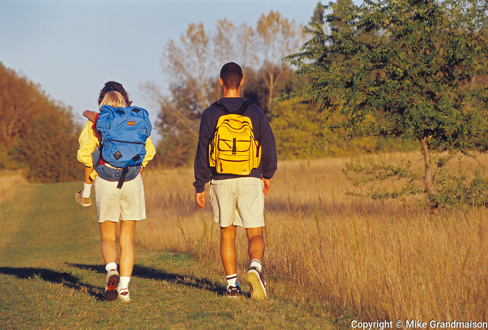 Young couple hiking a trail with child<br /> Birds Hill Provincial Park<br /> Manitoba<br /> Canada