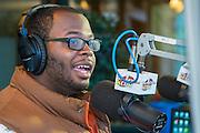 "North Forest High School senior Joseph Vaughns hosts his show ""Generation Next"" at the KCOH studio, September 20, 2014."