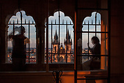A visitor is taking photographs on the top of the tower at the Old Town hall located at Old Town Square in Prague.