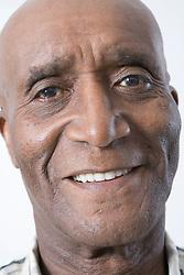 Portrait of an older man smiling,