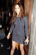 Olga Kurylenko, Vogue: Fashion's Night Out: Armani. Bond st.  London. 8 September 2010.  -DO NOT ARCHIVE-© Copyright Photograph by Dafydd Jones. 248 Clapham Rd. London SW9 0PZ. Tel 0207 820 0771. www.dafjones.com.