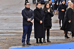 © Licensed to London News Pictures. 28/11/2018. Leicester, UK. Aiyawatt Srivaddhanaprabha, mother Aimon and daughter, Voramas visit a tribute site nearLeicester City Football Club King Power Stadium to pay tribute to those who were tragically killed in the helicopter crash at Leicester City Football Club's King Power Stadium. Their Royal Highnesses knew the Club's Chairman, Vichai Srivaddhanaprabha, and wanted to visit the city to recognise the warmth and compassion that the people of Leicester and fans of Leicester City Football Club have shown in reaction to the accident. Photo credit: Ray Tang/LNP