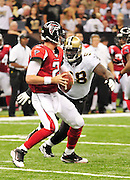 Defensive Tackle (98) Sedrick Ellis puts the hurt on Atlanta Falcons QB Matt Ryan  and sacks him late in the game on Sunday at the Super Dome. The Super Bowl Champions New Orleans Saints play the Atlanta Falcons Sunday Sept 26, 2010 in New Orleans at the Super Dome in Louisiana.  The Saints and Falcons are tied at half time and went into overtime tied 24-24. Hartley missed a kick to win in overtime., the Atlanta Falcons went on to win on OT with a field goal 27-24. PHOTO©SuziAltman.com