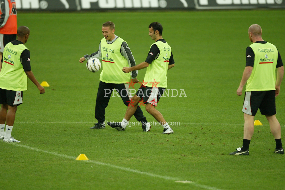 MILAN, ITALY - Thursday, September 4, 2003: Wales' Craig Bellamy and Ryan Giggs during training at the San Siro ahead of their Group 9 Euro 2004 qualifyer against Italy. (Pic by David Rawcliffe/Propaganda)
