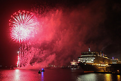 © Licensed to London News Pictures. 09/05/2014. Southampton, UK. Firework celebrations marking the 10-year anniversary of the Cunard flagship, Queen Mary 2, take place in the port of Southampton this evening, 9th May 2014. All 'three queens' of the Cunard fleet were present at the event, which included a 10-minute firework display, one minute for every year that the QM2 has been in service. Photo credit : Rob Arnold/LNP