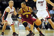 Dec. 2, 2010; Cleveland, OH, USA;  Miami Heat point guard Carlos Arroyo (8) puts pressure on Cleveland Cavaliers point guard Mo Williams (2) during the first quarter of the game at Quicken Loans Arena. Mandatory Credit: Jason Miller-US PRESSWIRE