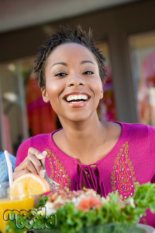 Smiling Woman Having a Salad