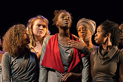 © Licensed to London News Pictures. 21/10/2013. Theatre Royal Stratford East presents Crowning Glory, a new play by Somalia Seaton that seeks to reveal a hidden world of unobtainable beauty by asking the question, how do women truly see themselves in today's world? Picture features (Centre) Rebecca Omogbehin (Bounty) & L-R: Allyson Ava-Brown, Katie Hayes, T'Nia Miller, Lorna Brown. Photo credit: Tony Nandi/LNP.