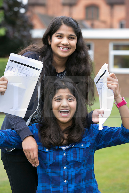 © Licensed to London News Pictures. 20/08/2015. Solihull, West Midlands, UK. GCSE results day at Solihull School. Pictured, Lili (blue top) and Kashee Mistry, twins, who achieved 19 (nineteen) A stars between them. Photo credit : Dave Warren/LNP