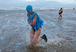 © Licensed to London News Pictures. <br /> 01/01/2017. <br /> Saltburn by the Sea, UK.  <br /> <br /> A small but hardy bunch of people run into the cold waters of the North sea as they take part in the annual New Year Day dip at Saltburn beach.<br /> <br /> The event helps to raise money for the Saltburn Animal Rescue Association.<br /> <br /> Photo credit: Ian Forsyth/LNP