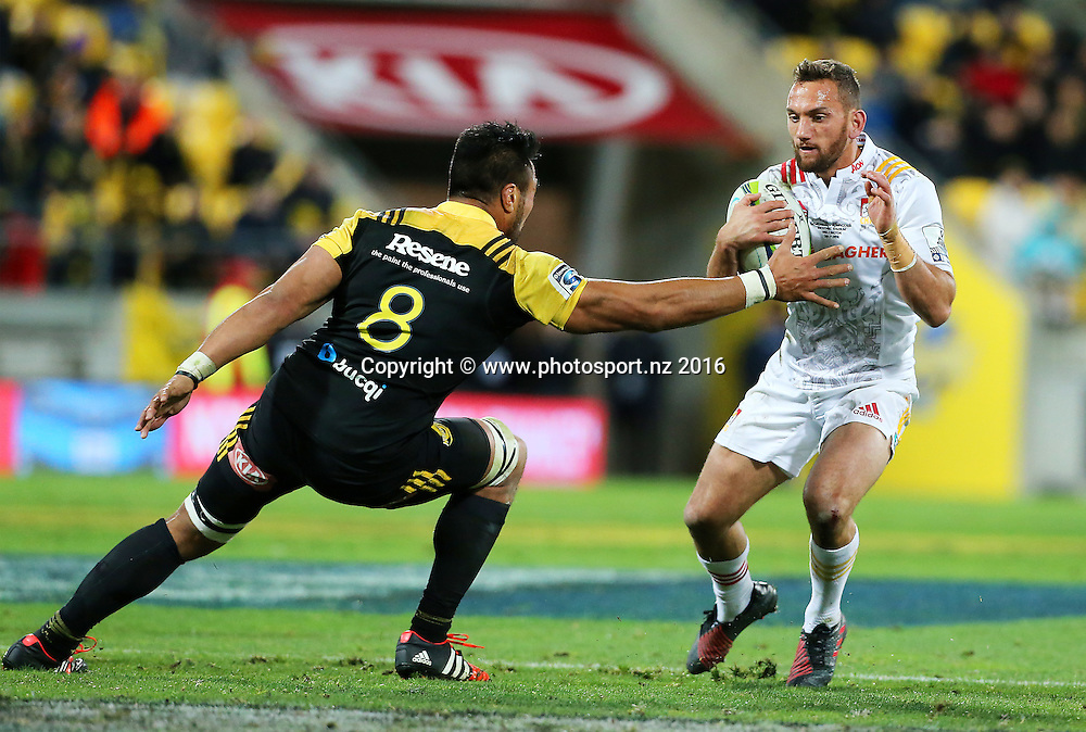 Chiefs' Aaron Cruden steps inside Hurricanes' Victor Vito  during the Investec Super Rugby Semi-Final match, Hurricanes v Chiefs at Westpac Stadium, Wellington, New Zealand. 30th July 2016. © Copyright Photo: Grant Down / www.photosport.nz
